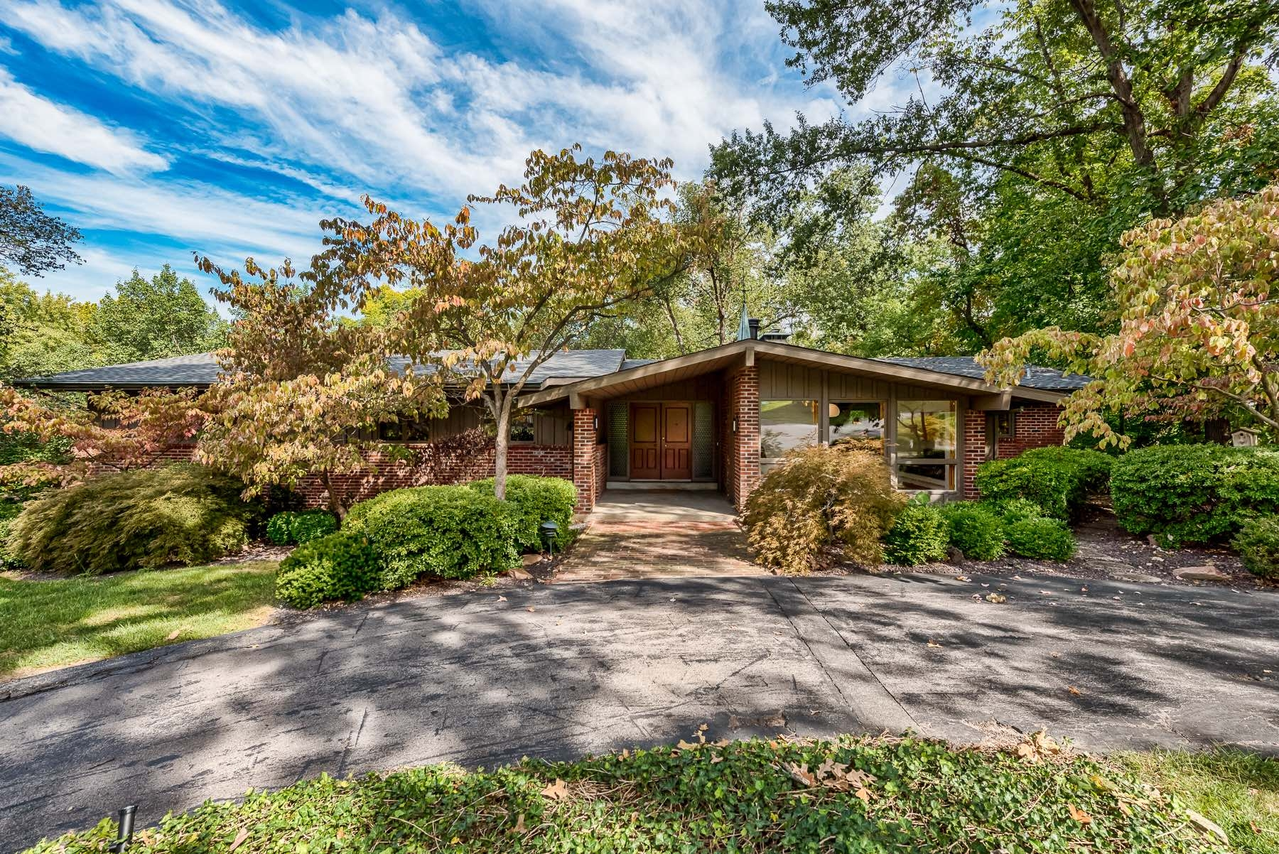 Photographs of a Ralph Fournier designed mid-century home on Copper Hill Road in Ladue, Missouri for Dielmann Sotheby's International Realty agent Ted Wight