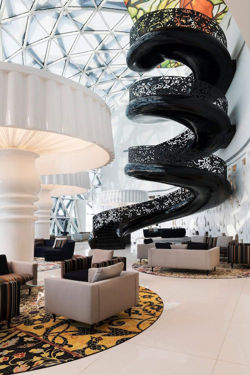 Between Those Seating Groups Rise Glossy White Trees. In The Main Lobby, A  Beautifully Sinister Looking Black Staircase ...