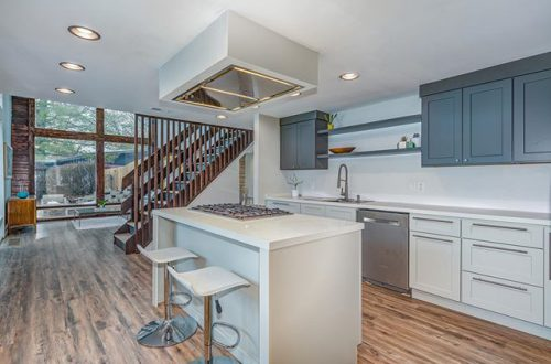 Walls of windows flood this completely renovated MCM home with light | 1217 Dubois Court now offered at $525,000 – from stlouis.style on Instagram